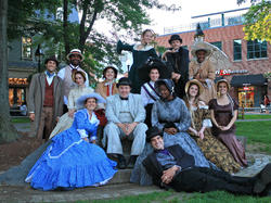 a group of people dressed up in historic clothing