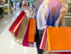 Woman holding several shopping bags