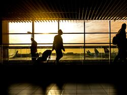 sunrise at airport with travelers