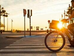 riding a bike at the sunset