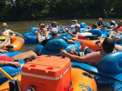 Group of people on floats at Zen Tubing near Mountain Inn & Suites