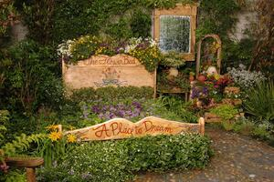 Garden with a sign that says