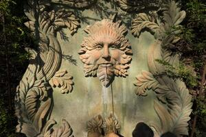 Garden fountain with a face