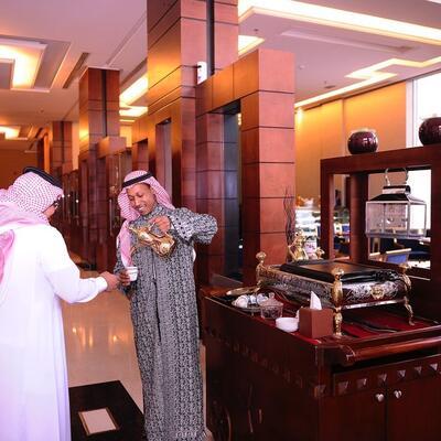 Men pooring coffee at Al Hamra Palace by Warwick