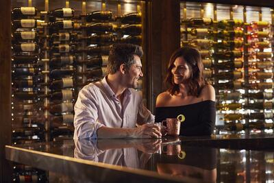 Couple drinking at hotel bar