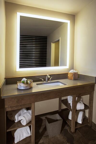 Hotel bathroom sink with lit vanity