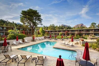 Courtyard hotel pool with view of Red Rocks.