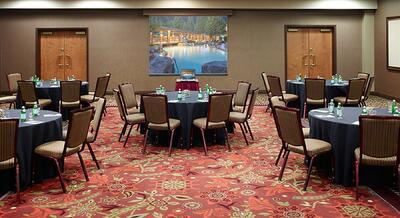 Set banquet tables in event room.