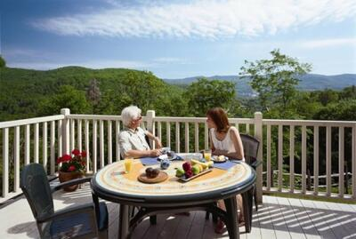 Couple eating on the deck with mountain views