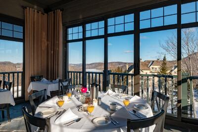 Dining tables by windows with mountain views