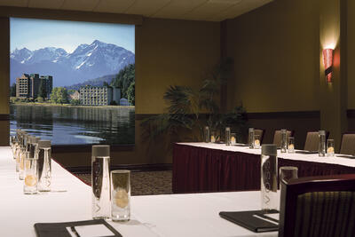 conference room with u shaped table and screen
