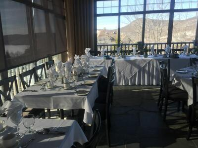 Wedding reception tables next to windows