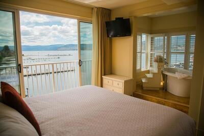 Hotel room with one bed and lake view.