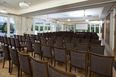 Meeting room with rows of chairs.