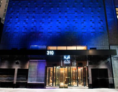 front of the aliz hotel building with blue lights