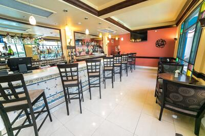 bar with bar stools and tables