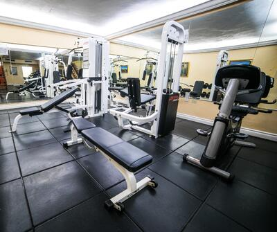 gym with bench and machines
