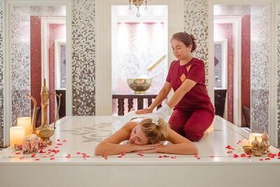 A guest having a massage at Amatara Wellness Resort