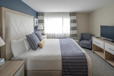 One bedroom suite with flat screen tv and chair