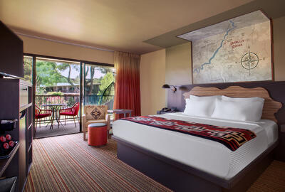Courtyard hotel room with king bed with view.