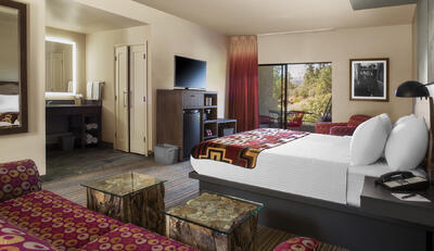 Hotel room with king bed & trailhead view.