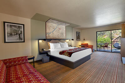 Hotel room with king bed & trailhead.