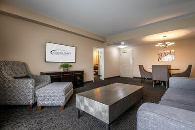 3 bedroom suite living room with dining table