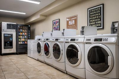 laundry room with snack machine and ice machine