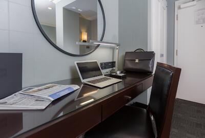 Business desk area of hotel room.