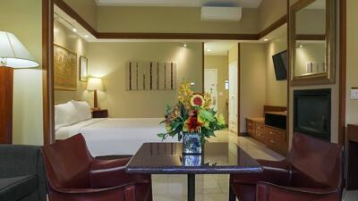 hotel suite with flowers on table