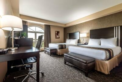 luxury room with two beds and desk