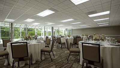 ballroom with table and chairs set for special event