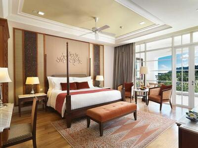 Grand Merchant room with hill views furnished with a king bed an