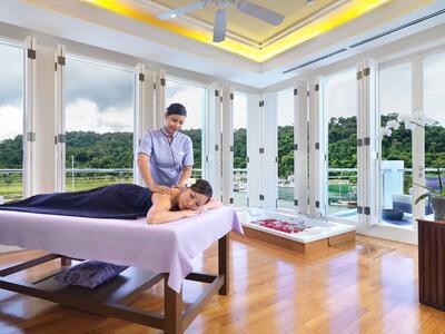 A lady enjoying a massage by a masseuse