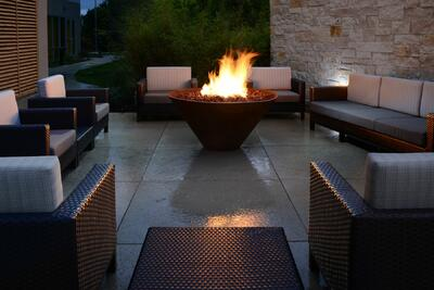 patio area with wicker furniture and fireplace