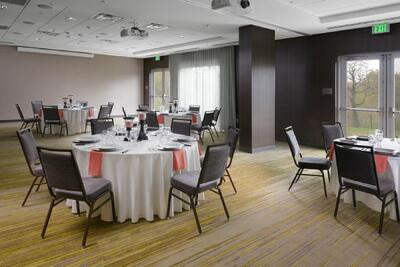 banquet hall with circular tables set up for event