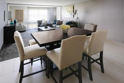 open dining room and living room with curtains covering windows