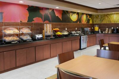 open café with continental breakfast on shelves