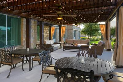 outdoor patio with assorted seating and hanging lights
