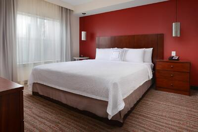 room with king bed and nightstand