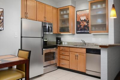 small kitchen with fridge, oven and dishwasher