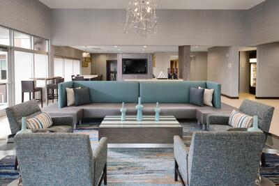 lobby area with large sofa and accent chairs