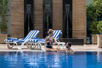 Swimming Pool at Ghaya Grand Hotel Dubai