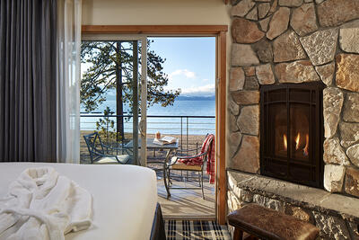 Superior Lake room with view of lake and fireplace