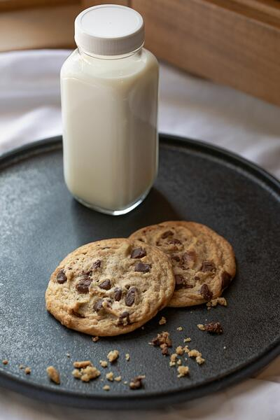 two cookies and a jar of milk