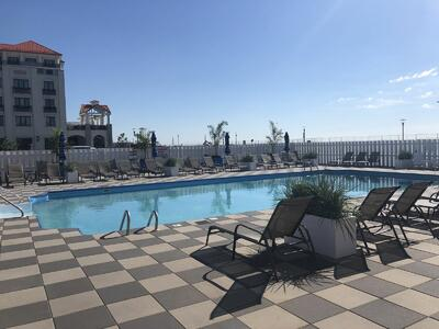 lounge chairs surround a hotel pool