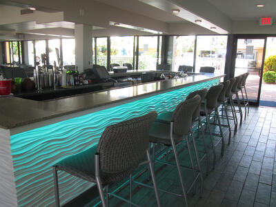 chairs line a bar area
