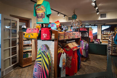 t-shirts and skim boards in a store