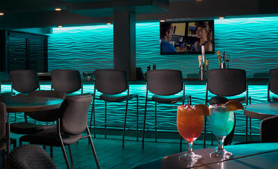 two cocktails in a bar area