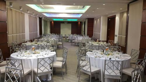 banquet room with chairs set up for conference
